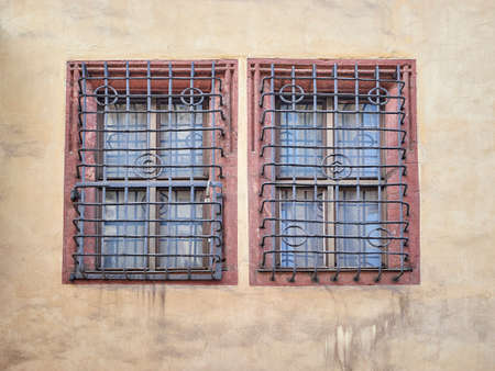 iron barred: vintage windows secured with metal bars
