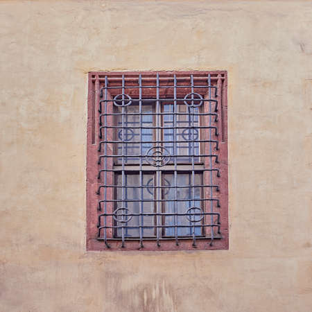 iron barred: vintage window secured with metal bars