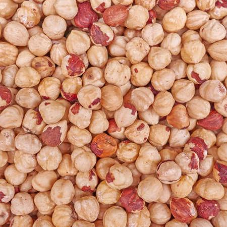 close up food: peeled hazelnuts close up, vegetarian food background