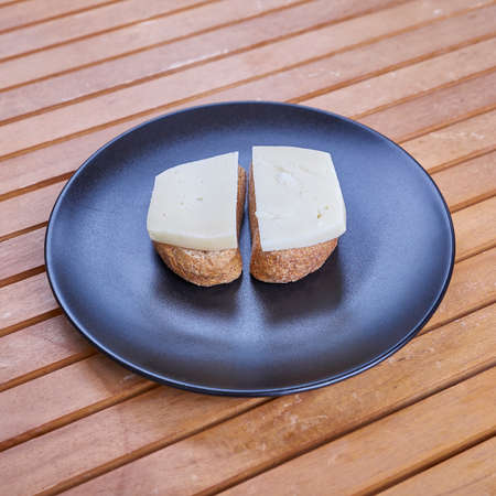 gruyere: healthy mediterranean food, Cretan barley rusks with local gruyere cheese