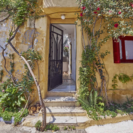 islanders: Athens Greece, house entrance at Anafiotika, an old neighborhood under acropolis, built by Anafi islanders according to their tradition around 1840 Stock Photo