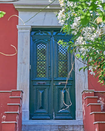 view of a wooden doorway: Athens Greece, house door in Plaka old neighborhood under acropolis