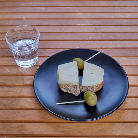 gruyere: Cretan barley rusks with local gruyere cheese, green olives and a glass of raki