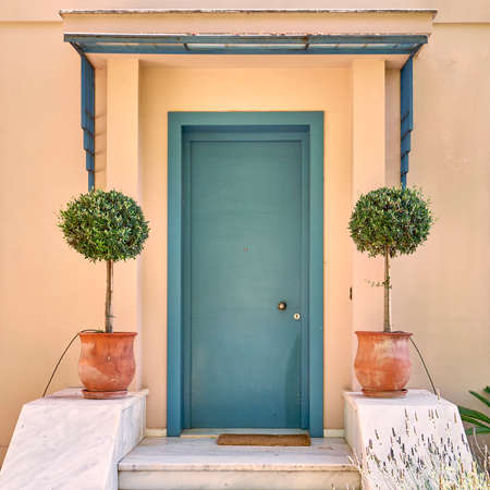 contemporary house green door and flowerpots, Athens Greece