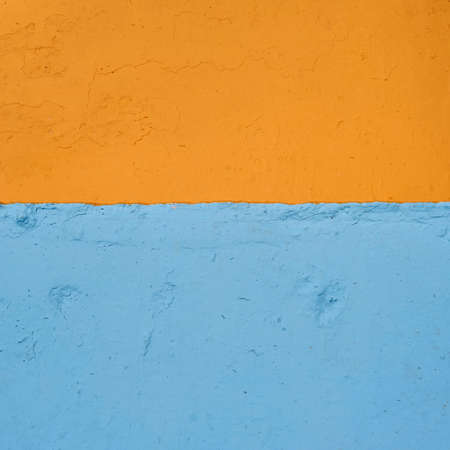 surface closeup: vibrant orange and blue rough surface close-up