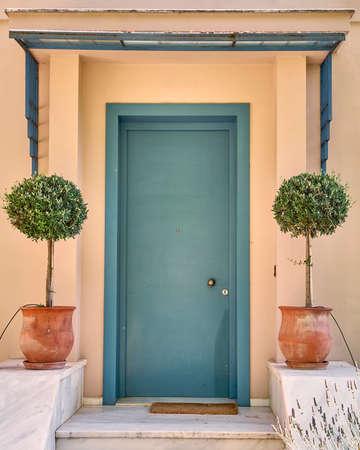 flowerpots: contemporary house green door and flowerpots, Athens Greece