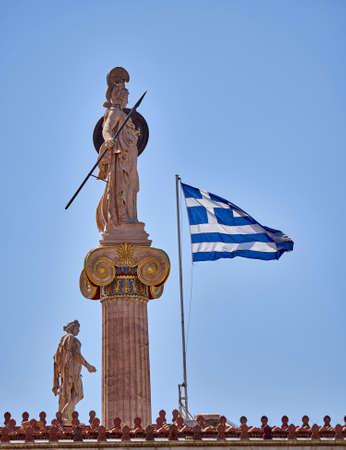 athena: Athena and Apollo statues and Greek flag unusual view Stock Photo