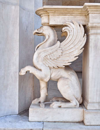 creature: griffin, mythical creature marble statue closeup Stock Photo