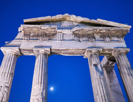 moon gate: Night in Athens Greece, the entrance of the Roman forum under the moonlight