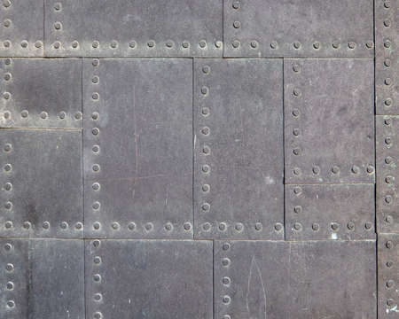 aircraft rivets: vintage metallic square pattern suface closeup