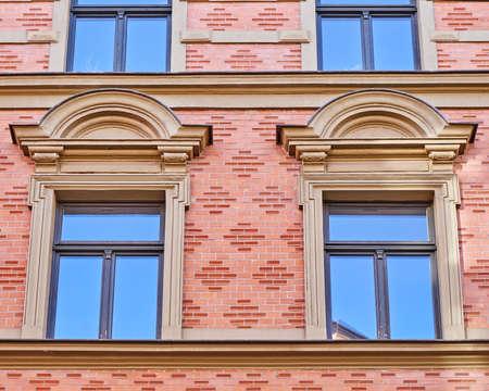 twin house: twin windows on elegant house facade