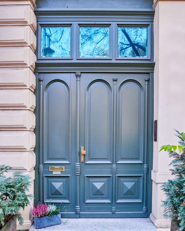 green door: elegant dark blue green door and flowerpot Stock Photo