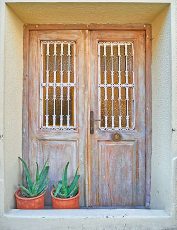 down town: Greece, vintage door and flowerpots in down town Athens Stock Photo