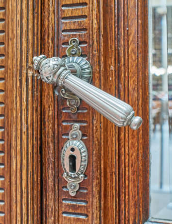 door handle: vintage wooden door bronze handle Stock Photo