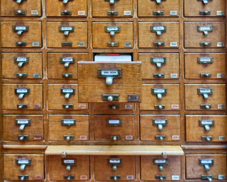 archival: vintage archive wooden drawers closeup Stock Photo