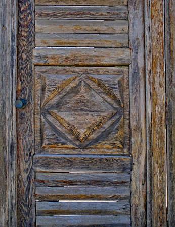 rhomb: vintage wooden door with rhomb closeup