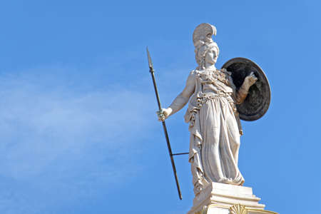 Greece, Athena the goddess of knowledge and wisdom statue, space for typing on blue sky Publikacyjne