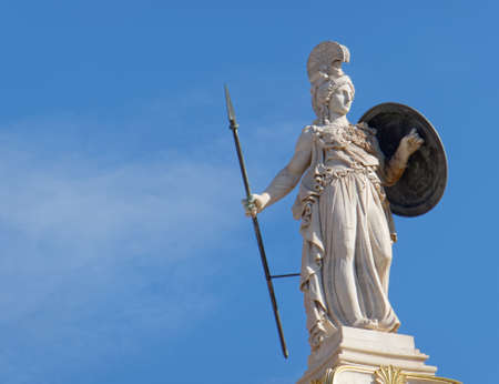 Athena statue on blue sky background, ancient greek godess of knowledge and wisdom
