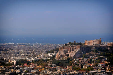 Greece, Parthenon famous temple on acropolis hill and the athenian riviera as a distant background