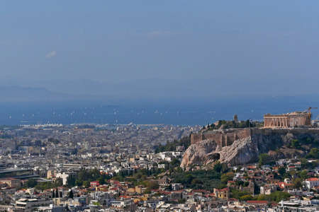 Greece, Athens cityscape with acropolis and saronic gulf as distant background