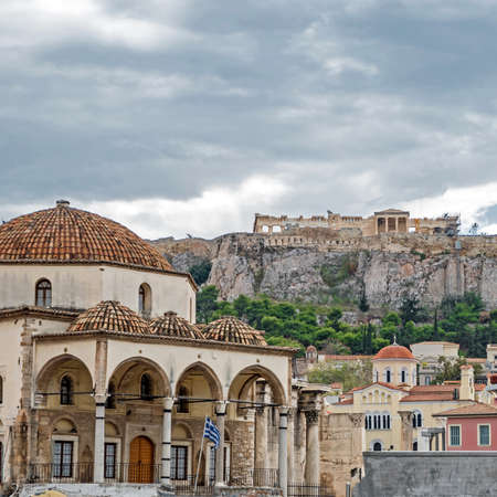 clouds over Athens Greece, tzistarakis mosque on monastiraki square under acropolis hill