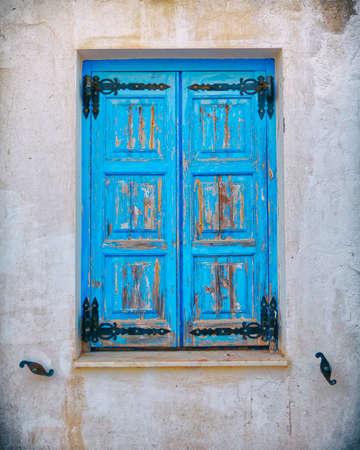 Greek island house, colorful blue window
