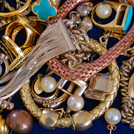 variety of golden jewlry top view, precious background