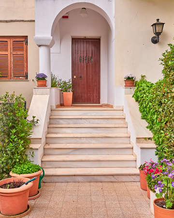 elegant residence entrance wooden door and stair