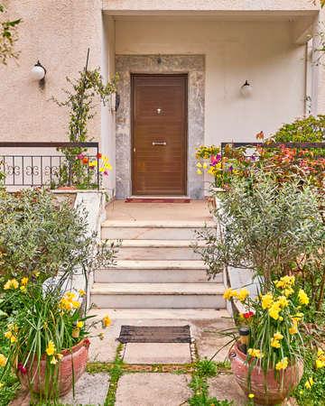 elegant residence entrance wooden door and stair Stock fotó
