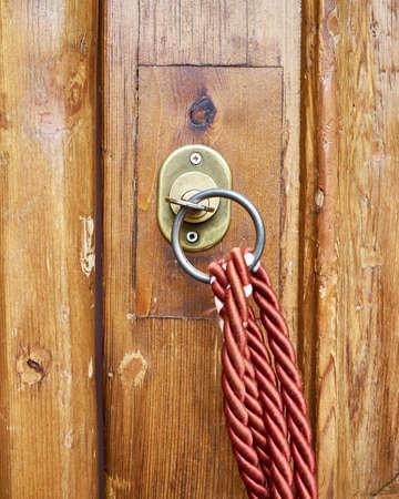 vintage key lock on brown solid wood door closeup with red cord Stock fotó