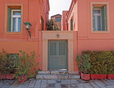 colorful saumon house front at Plaka picturesque neighbohood, Athens Greece