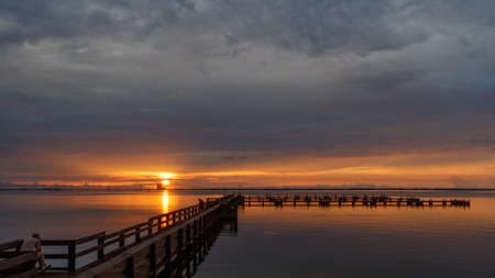 Sunrise with clouds and dock at Banana River, Merritt Island, Florida, USA Stock Photo