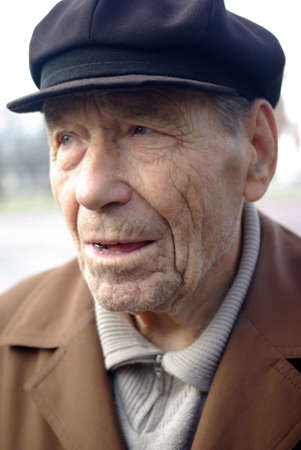 men faces: Portrait of poor elderly man