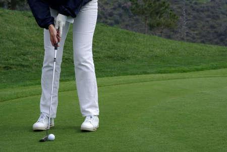 Golfer putting the ball Stock Photo