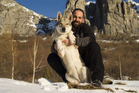 Man with dog in winter forest Stock Photo - 8947831