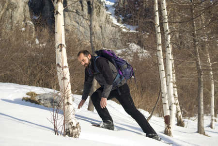 Man in snow shoes photo