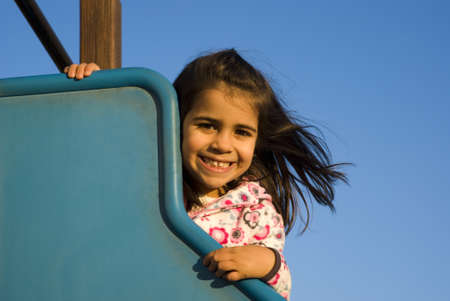 baby girls smiley face: Little girl at playground