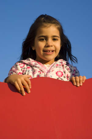 Little girl at playground Stock Photo - 9411265