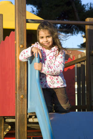 baby girls smiley face: Girl playing at the playground