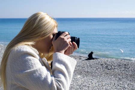 Woman taking photos photo