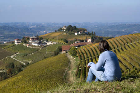 Woman sitting on a hill looking a the view  photo