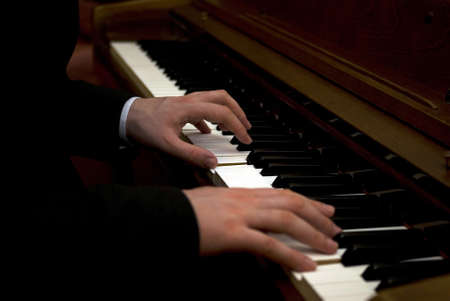 Musician playing the piano photo
