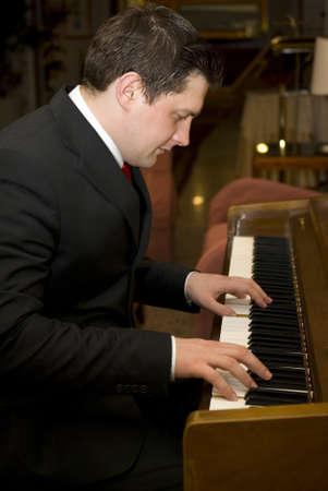 Man playing piano photo