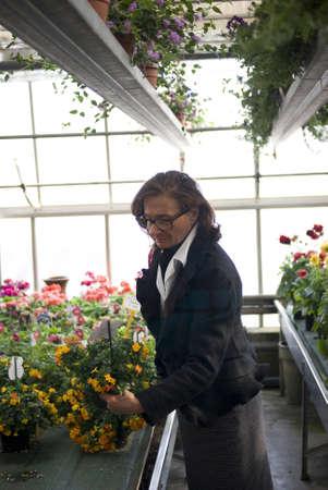 Senior lady at plant nursery photo