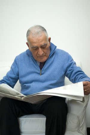 Senior man reading the newspaper Stock Photo - 9811201