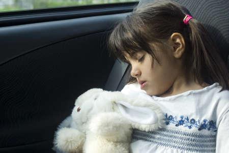Girl sleeping in the car photo