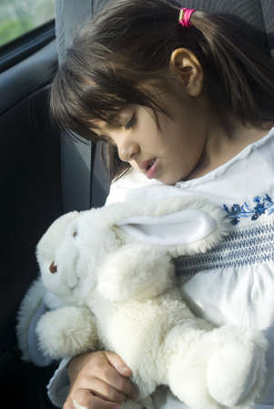 Girl sleeping in the car photo