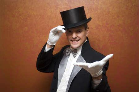 Magician performing a magic trick Stock Photo