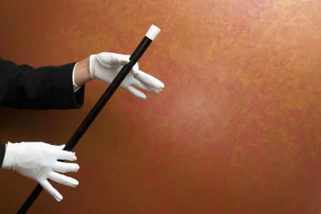 Magician performing with wand 스톡 콘텐츠