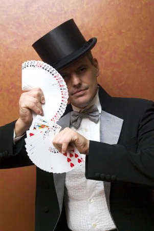 Magician performing with cards photo
